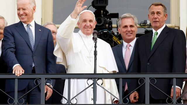 WASHINGTON, DC - SEPTEMBER 24:  Pope Francis waves to crowd from the balcony of the US Capitol building, after his address to a joint meeting of the U.S. Congress, September 24, 2015 in Washington, D.C.  Joining him are, ( L to R)Arch Bishop Joseph E. Kurtz, Vice President Joe Biden, Senate Majority Leader Kevin McCarthy of California, House Speaker John Boehner Nancy Pelosi, Minority Leader, Cardinal Donald Wuerl. (Photo by Evy Mages/Getty Images)