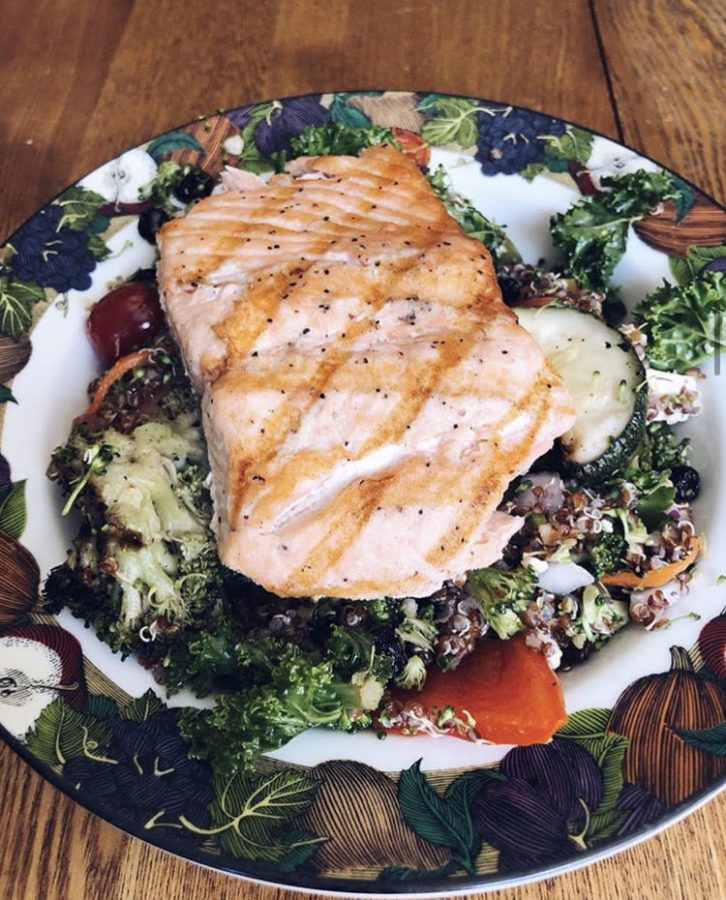 A meat-free alternative: Salad with salmon, kale, quinoa, and veggies