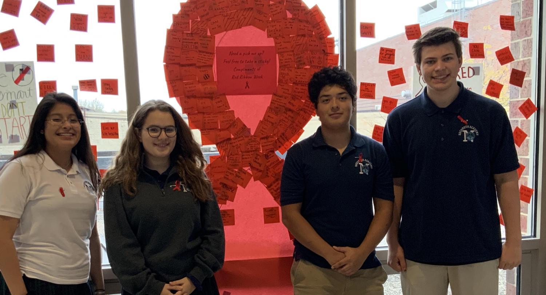 Freshmen Michelle Toledano and Hannah Cole and Seniors Juan Ramirez and Adam Korinek support Red Ribbon Week