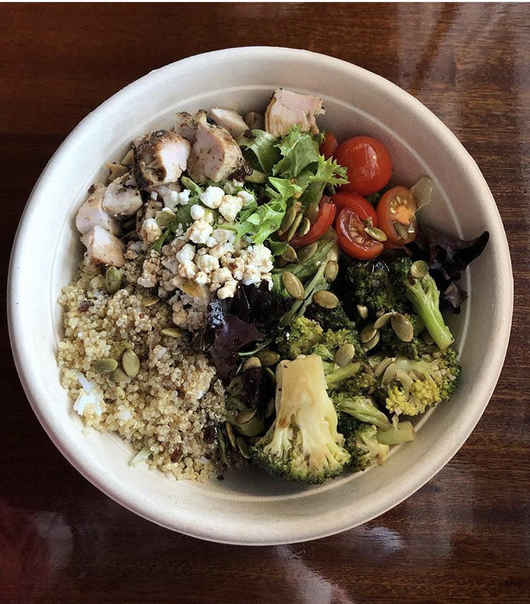Salad with grilled chicken, quinoa, and vegetables