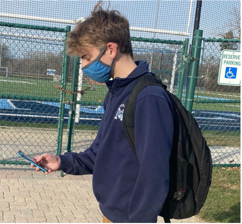 Sophomore Patrick Titzer using Social Media outside of school.