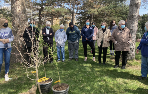 Sisters from The Congregation of St. Joseph, faculty, and students come together to bless the trees before planting them.
